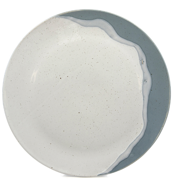 The 28 cm Blue Roam Dinner Plate by Salt & Pepper. Crafted from speckled pottery, this plate embodies elegance and flow with its two-colour hand-dipped aesthetic