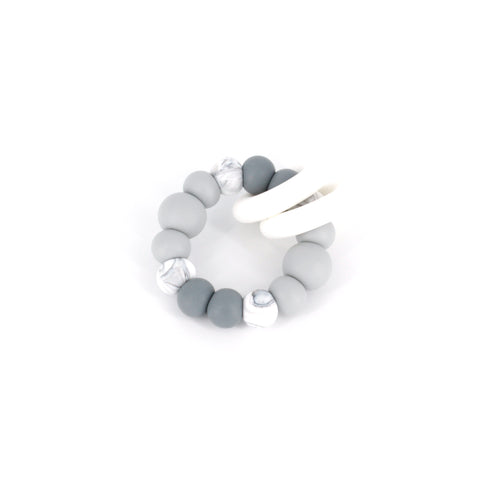 Ease your bubs teething with these Trio Teethers in Grey Ombre!  Designed by Lluie in Melbourne, Australia; the TRIO teether features 2 silicone donut rings which circulate the larger beaded silicone ring.