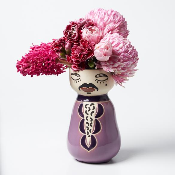 We reckon Prince is one of the greatest of all time so why not immortalise his purpleness the only way we know how: in a super cute Jones & Co face vase!