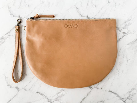 A handy quintessential clutch to manage all those bundles in your life, the Biscuit New Moon purse from Ovae will happily journey with you through all stages of life!