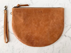 A handy quintessential clutch to manage all those bundles in your life, the Pecan New Moon purse from Ovae will happily journey with you through all stages of life!