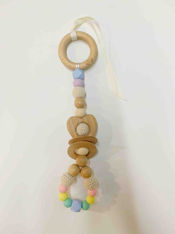Ease your bubs teething with this Pastel Rainbow Love Teething Rattle Toy!  Designed by Lluie in Melbourne, Australia; the Love Teething Rattle Toy encourages little ones to explore important milestones through tummy time or whilst lying on their backs.