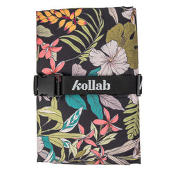 This vibrant Hibiscus Mini Picnic Mat from Kollab is perfect for the park! These water resistant mats have been specially designed with an adjustable strap so that they don't need to be folded in any specific way. Just roll it up however you please and adjust the strap to suit!