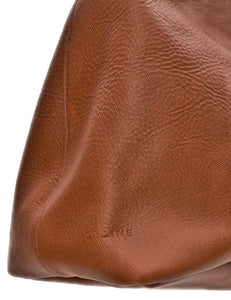 Australian made tan leather cross-body bag - logo
