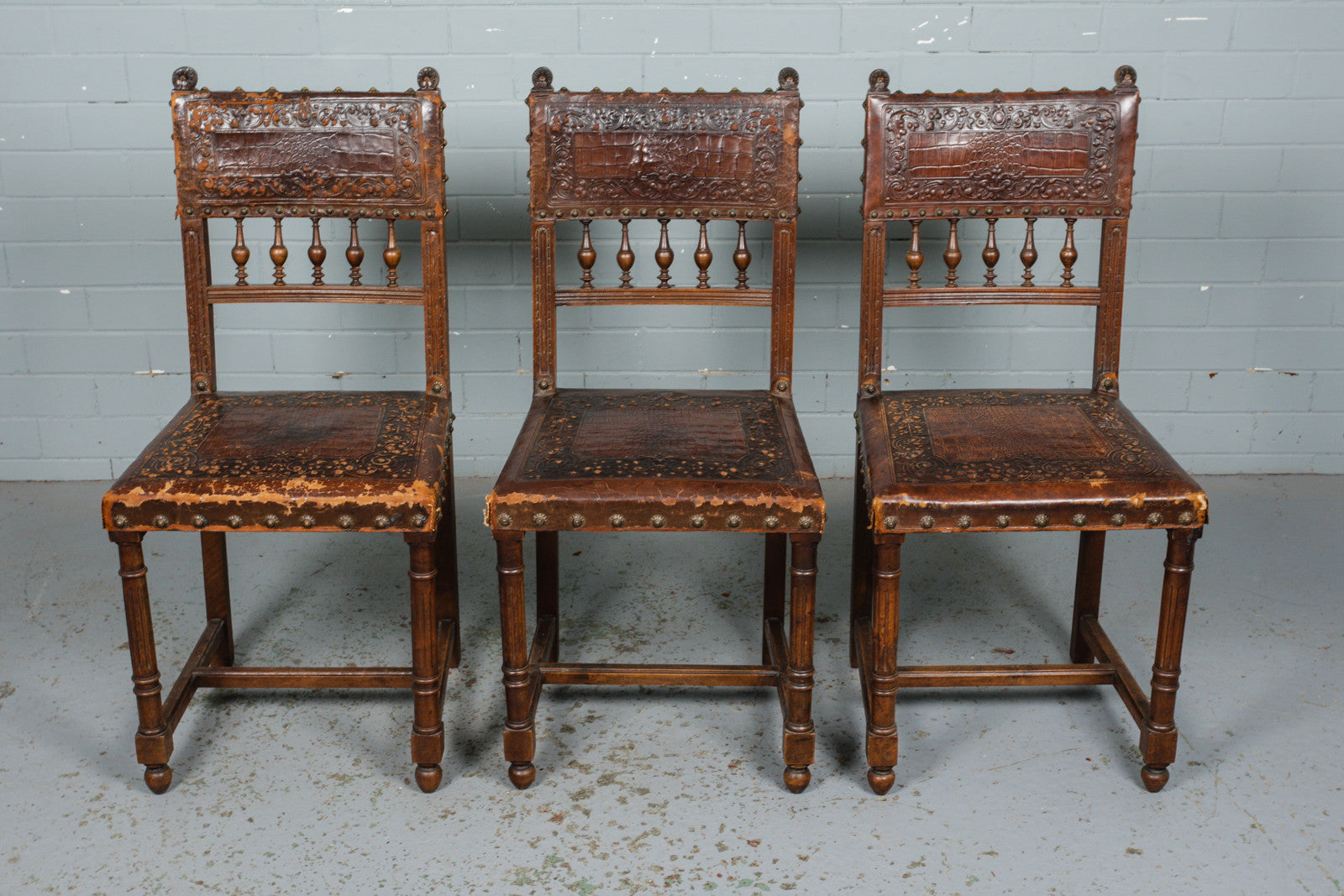 Set of Six French Neo-Renaissance Embossed Leather Dining Chairs