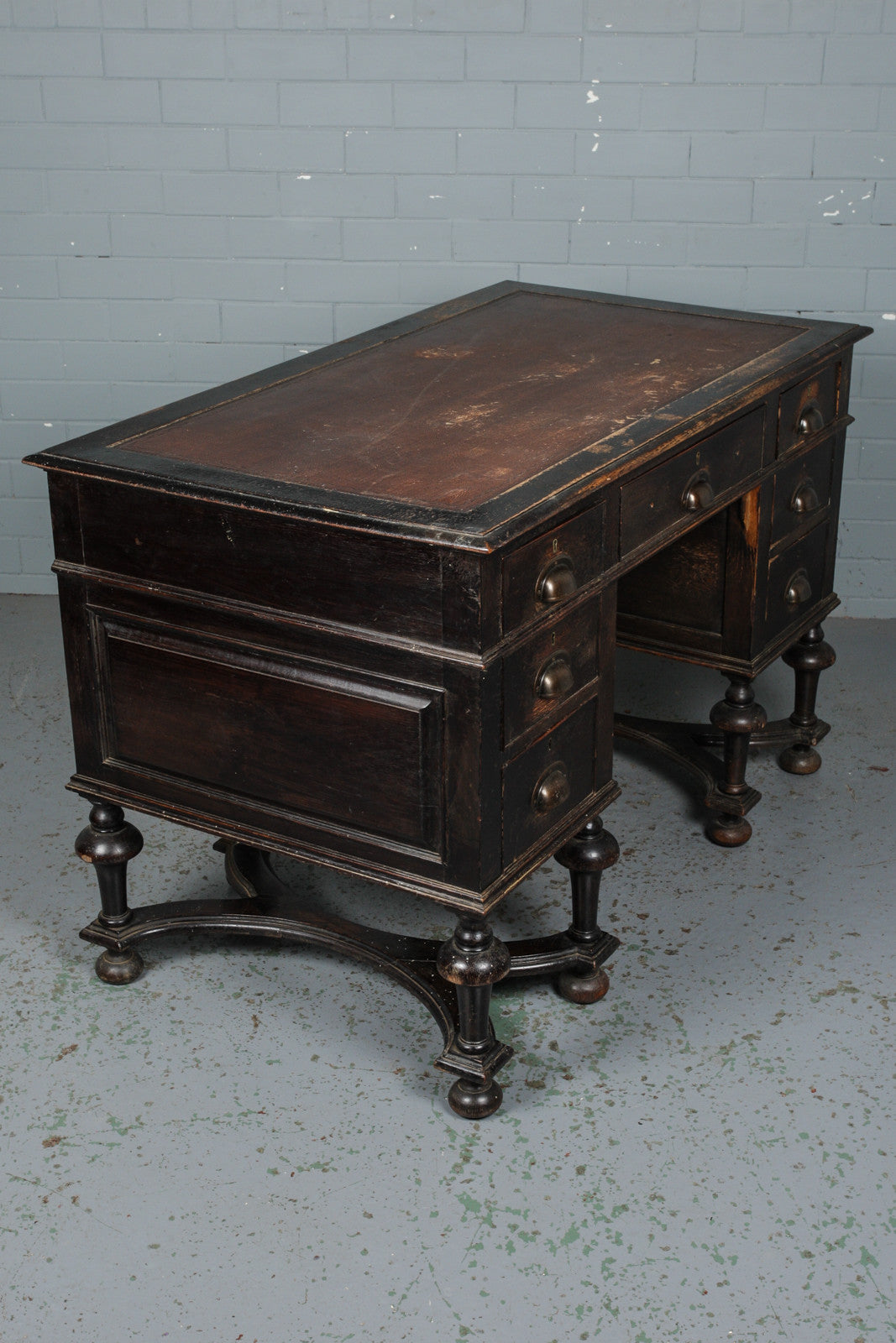 A Victorian ebonised and leather topped kneehole desk available to buy from Industrious Interiors, an online vintage furntiure and homeware store based in Nottingham, England.