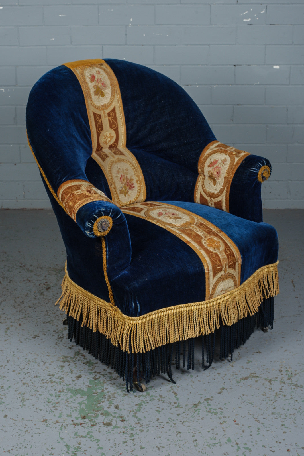 Victorian blue and yellow velvet armchair vagina available to buy for Industrious Interiors, an online vintage furniture and homeware store based in Nottingham.