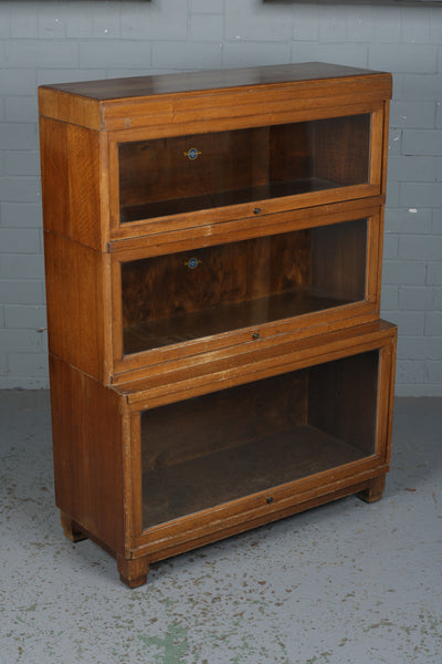 A Globe Wernicke Ltd stacking barrister oak bookcase available to buy from Industrious Interiors, an online furniture and vintage store based in Nottingham, England.