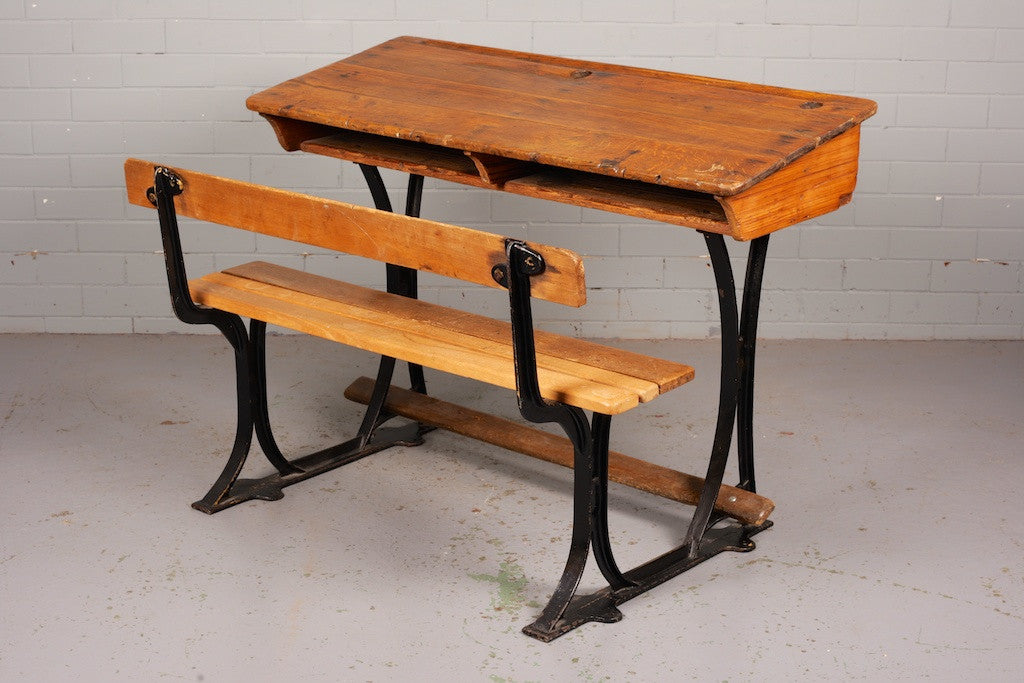 Oak double school desk with attached bench seat, under desk storage, cast  iron legs - Antique Oak School Desk And Bench – Industrious Interiors
