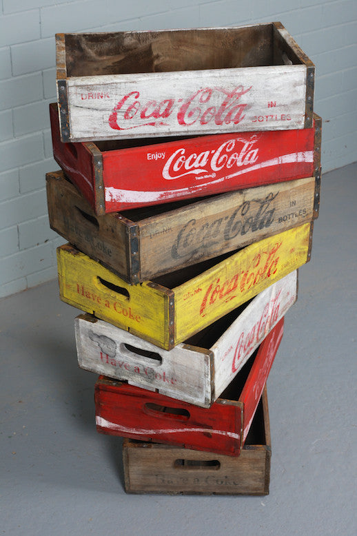 Wooden Coca Cola crates available to buy at Industrious Interiors, an online vintage furniture and homeware store based in Nottingham, England.