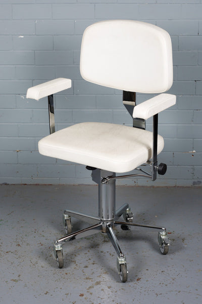 A white, vinyl vintage salon or beautician's chair for sale at Industrious Interiors, an online vintage furniture and homeware store based in Nottingham, England.