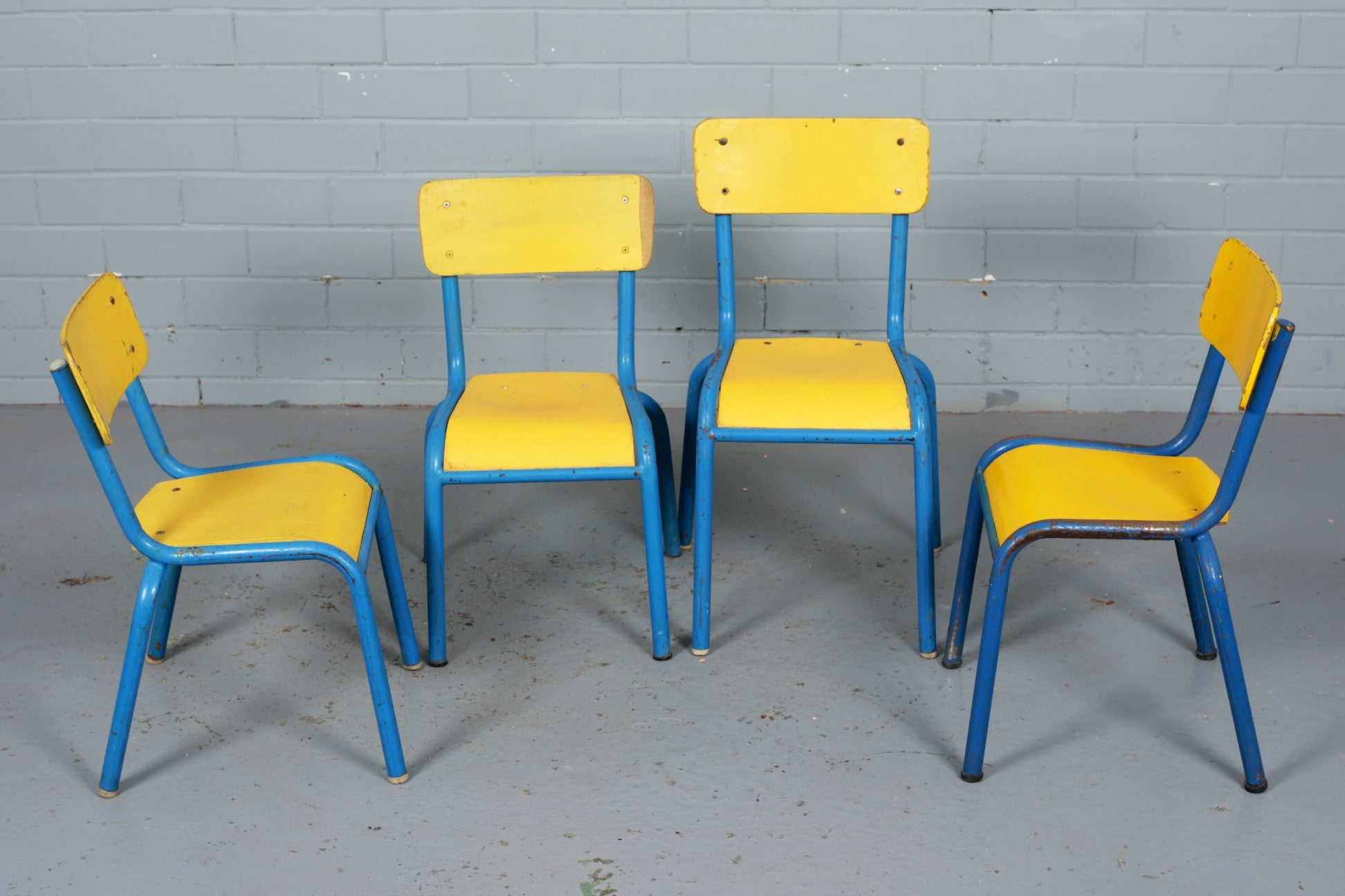 French stackable wooden and steel children's chairs for sale at Industrious Interiors, an online vintage furniture and homeware store based in Nottingham, England.