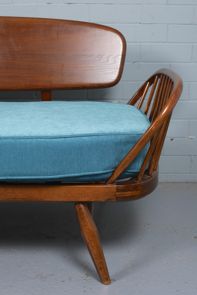 A 1950s Ercol daybed for sale at Industrious Interiors, an online vintage furniture and homeware store based in Nottingham, England.