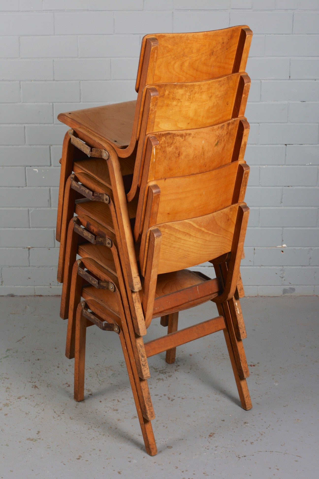 Wooden stacking and linking chairs for sale at Industrious Interiors, an online vintage furniture and homeware store based in Nottingham, England.