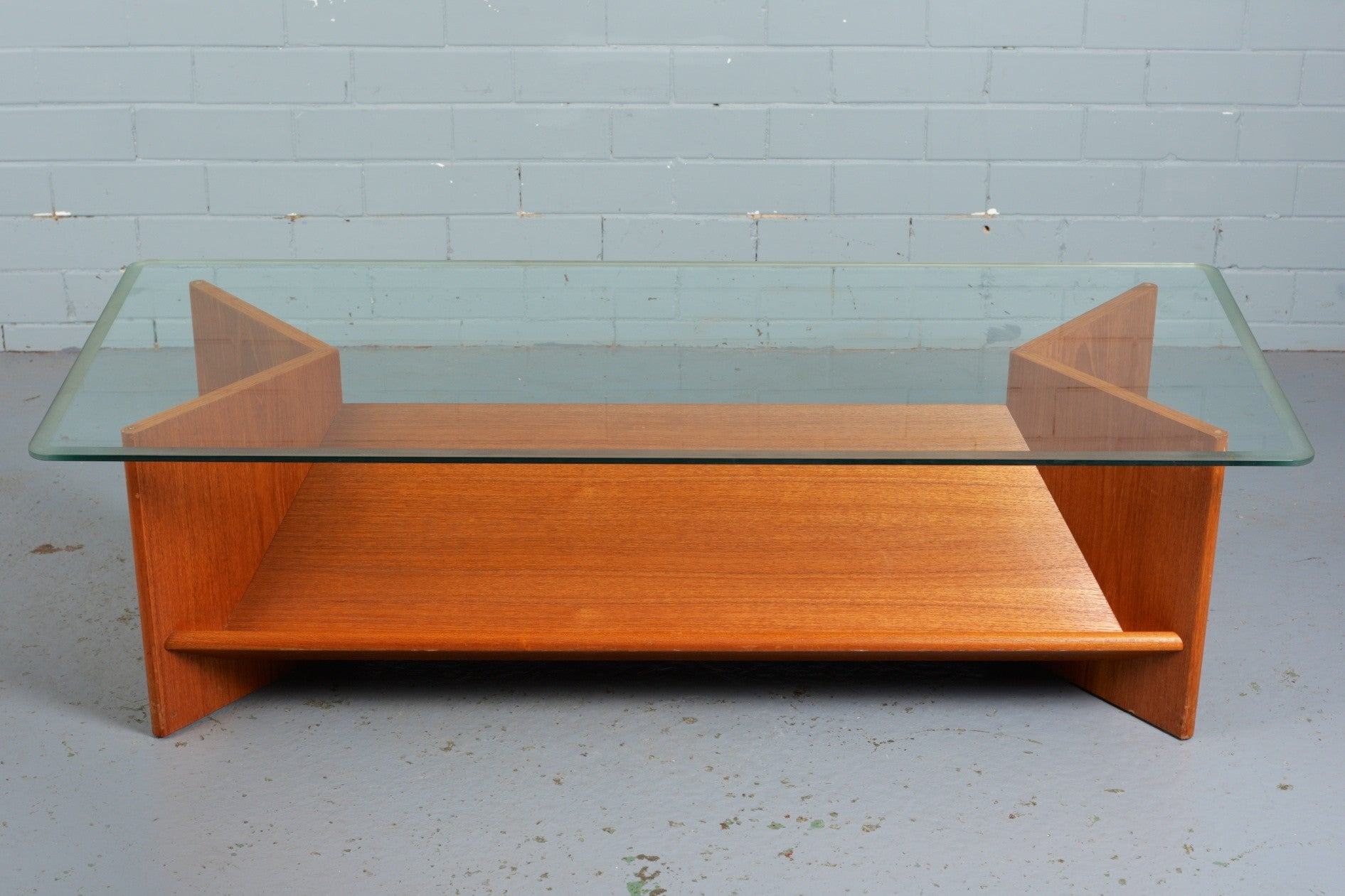 Teak and glass coffee table for sale at Industrious Interiors, an online vintage furniture and homeware store based in Nottingham, England.