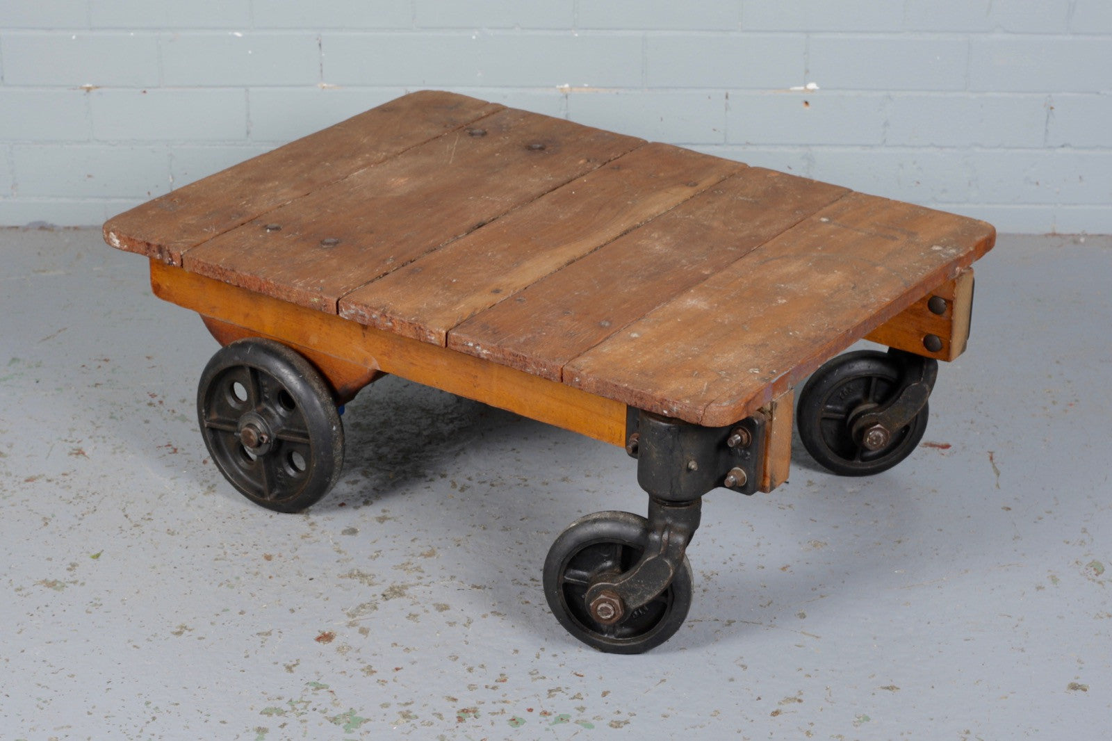 Industrial wooden trolley for sale at Industrious Interiors, an online vintage furniture and homeware store based in Nottingham, England.