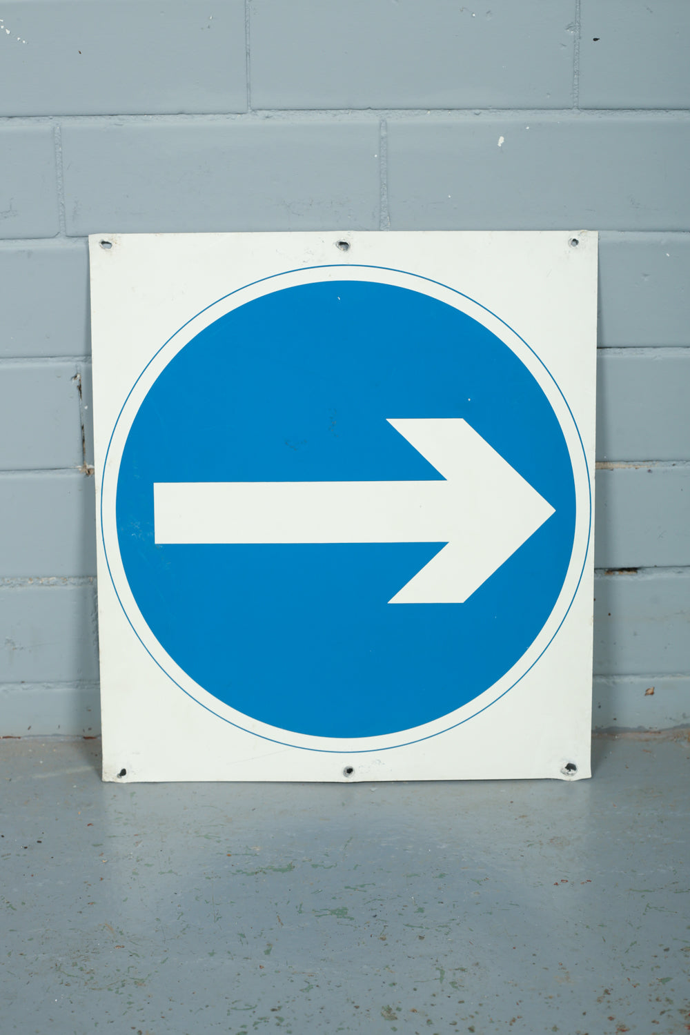 Blue and white original enamel arrow traffic signs available to buy from Industrious Interiors, an online vintage furniture and homeware store based in Nottingham, England.
