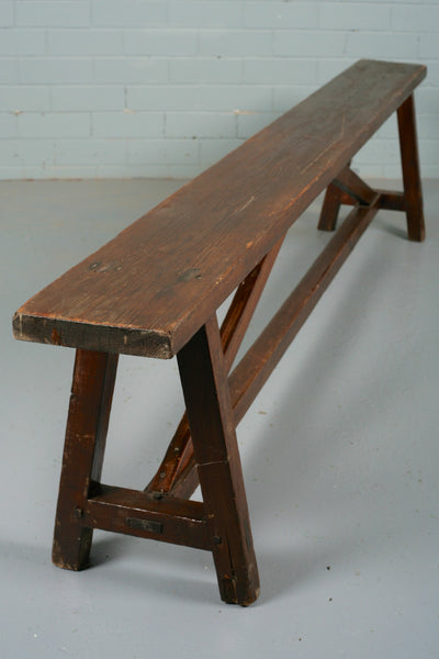 A long pine bench for sale at Industrious Interiors, an online vintage furniture and homeware store based in Nottingham, England.
