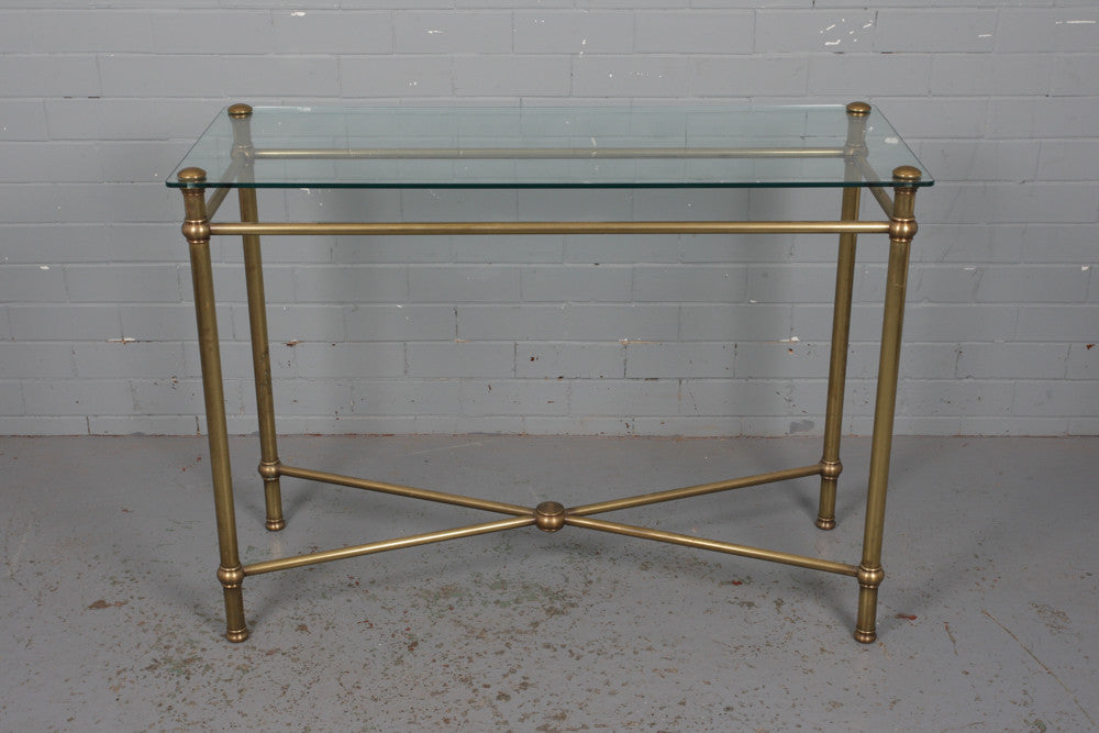 A brass and glass console table available to buy at Industrious Interiors, an online vintage furniture and homeware store based in Nottingham, England.