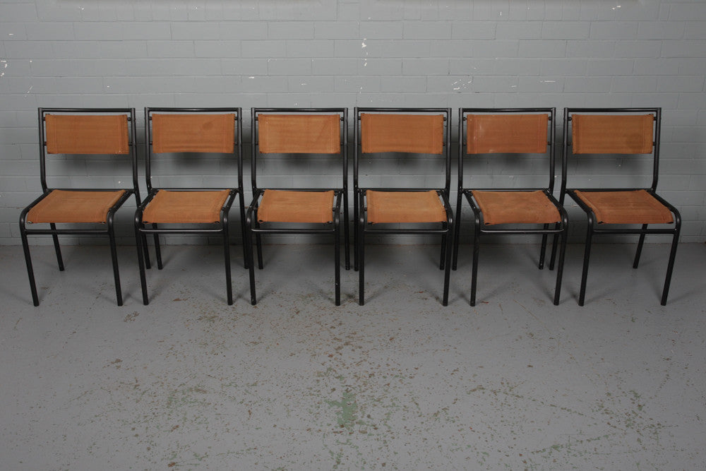 A set of six canvas and tubular steel stacking chairs available to buy at Industrious Interiors, an online vintage furniture and homeware store based in Nottingham, England.