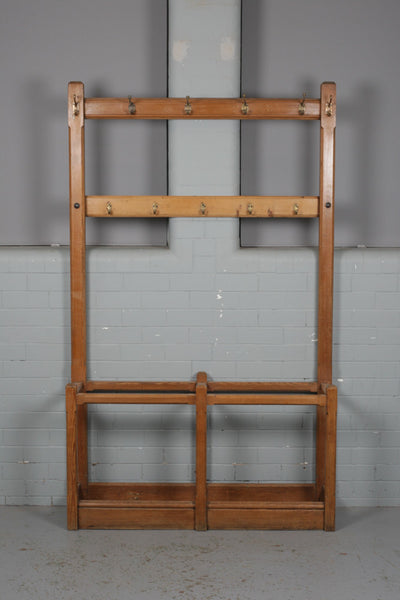 A large, solid pitch pine hall stand for sale at Industrious Interiors, an online vintage furniture and homeware store based in Nottingham, England.