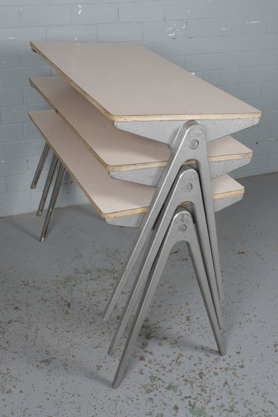 An original formica and aluminium Esavian school stacking table available to buy from Industrious Interiors, an online vintage furniture and homeware store based in Nottingham, England.