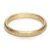 A classic men's textured wedding band in yellow gold, handmade in London by Ruth Tomlinson