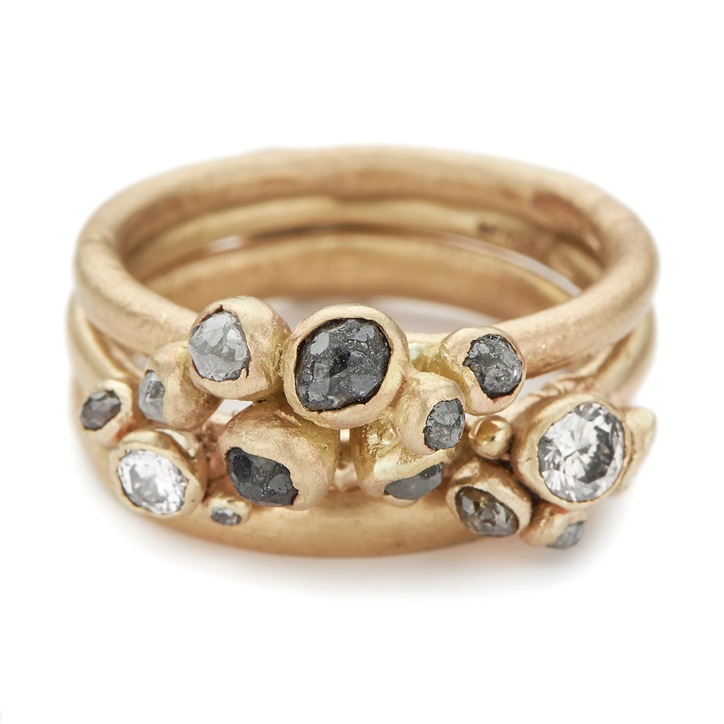 Grey and white diamond ring stack from Ruth Tomlinson, handmade in London
