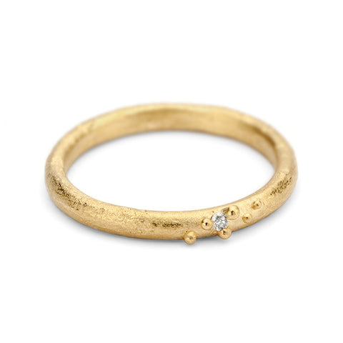 f060f4c423f Ladies yellow gold wedding band with diamond detail from Ruth Tomlinson