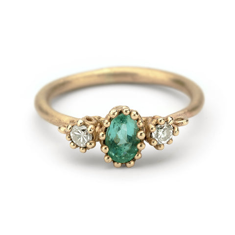 Emerald and diamond alternative engagement ring from Ruth Tomlinson, handmade in London