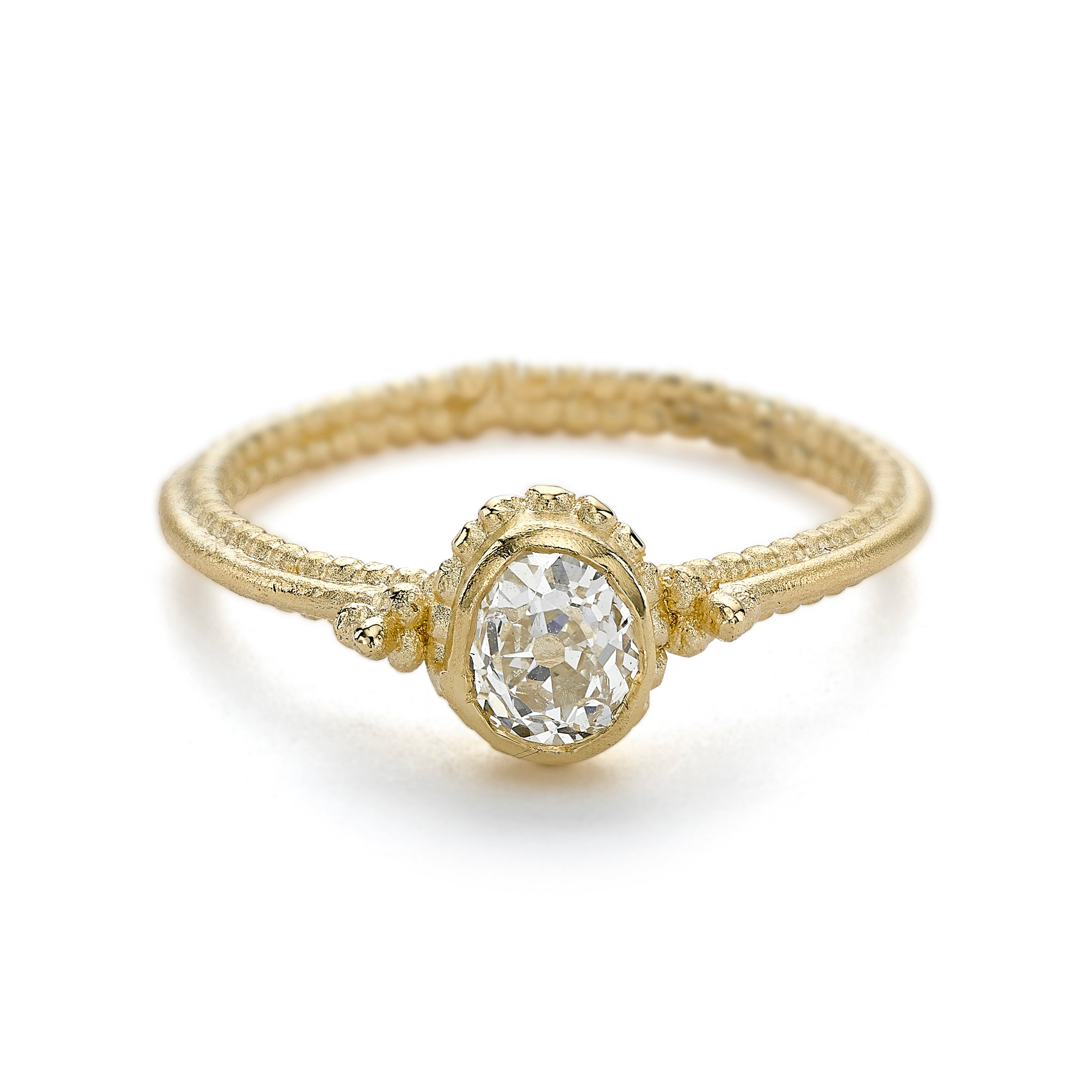 Unique vintage inspired solitaire diamond engagement ring with beaded setting by Ruth Tomlinson, handmade in London