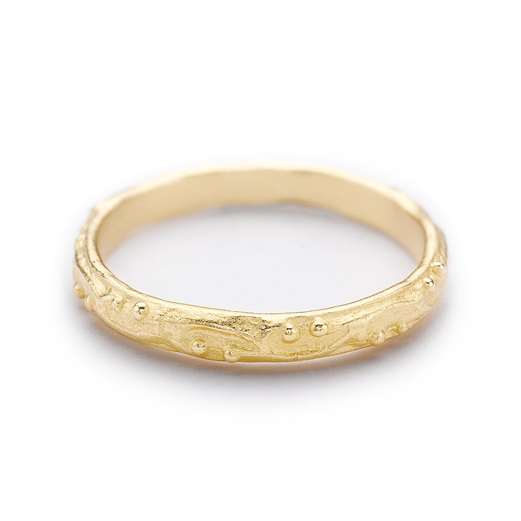 Decorative wedding band with scroll details from Ruth Tomlinson, handmade in London