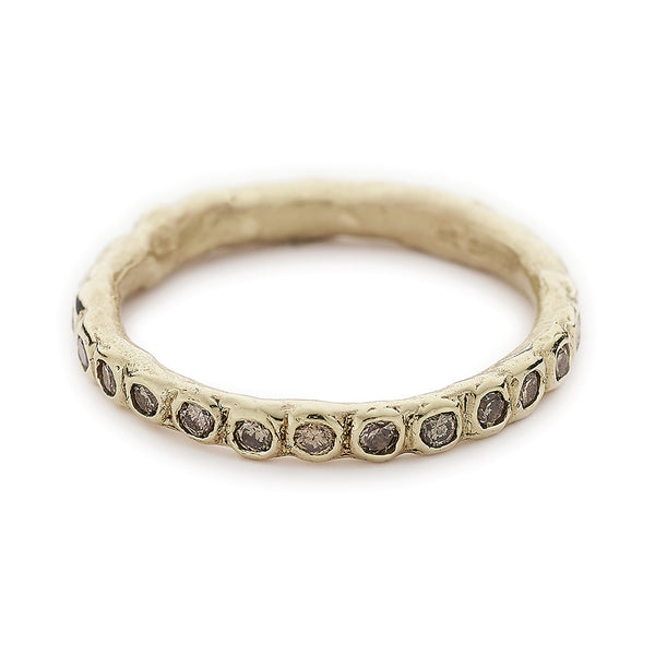 Wide champagne diamond eternity band in yellow gold by Ruth Tomlinson, handmade in London