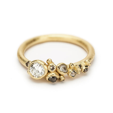 Diamond cluster engagement ring with antique diamond from Ruth Tomlinson