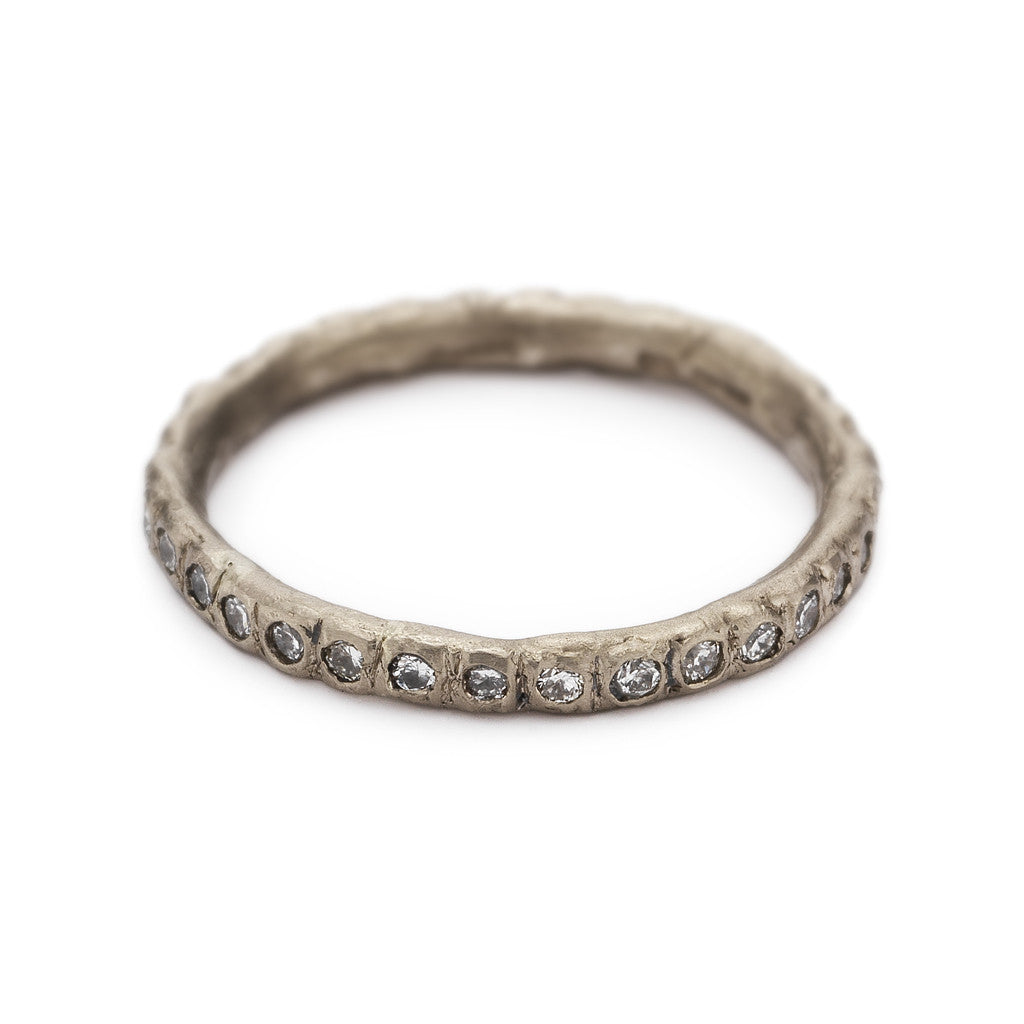 Eternity band in white gold with white diamonds by Ruth Tomlinson, handmade in London