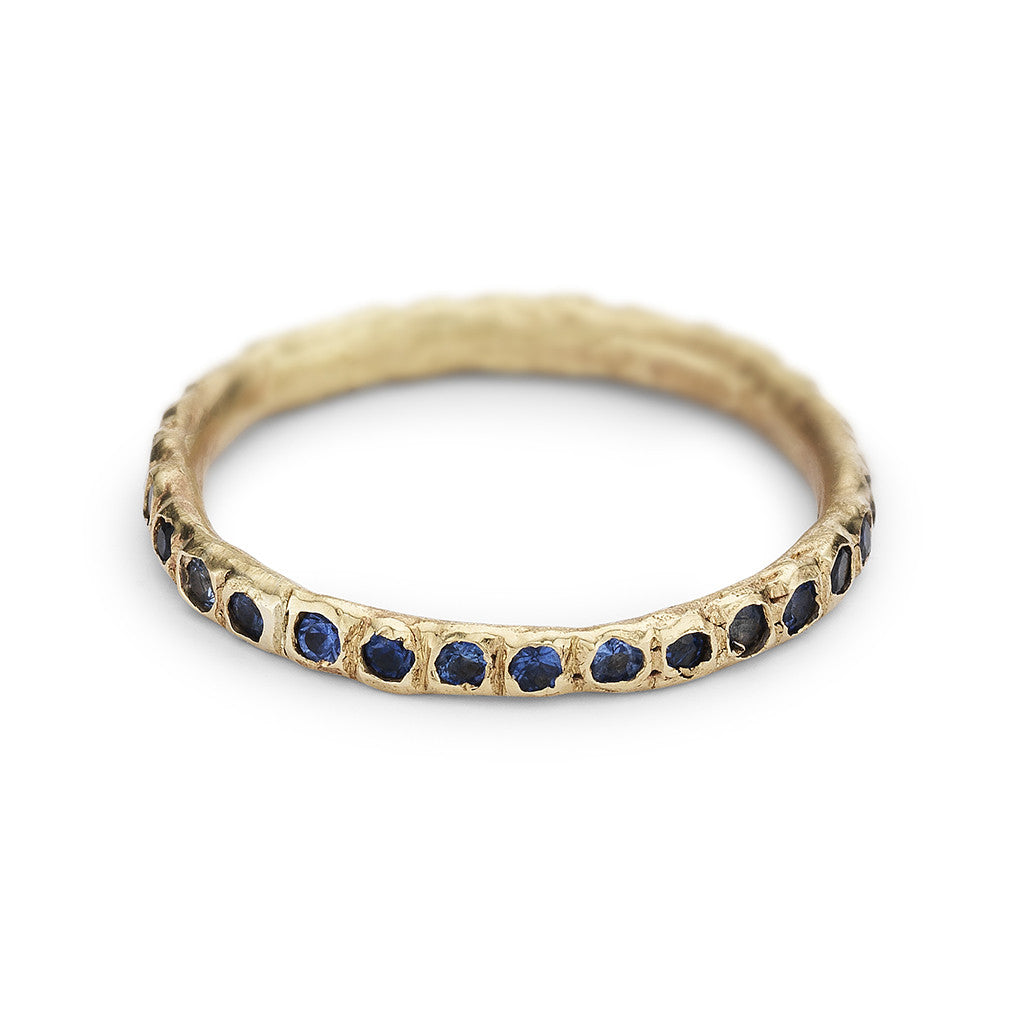Sapphire eternity band in 14ct yellow gold, handmade in London