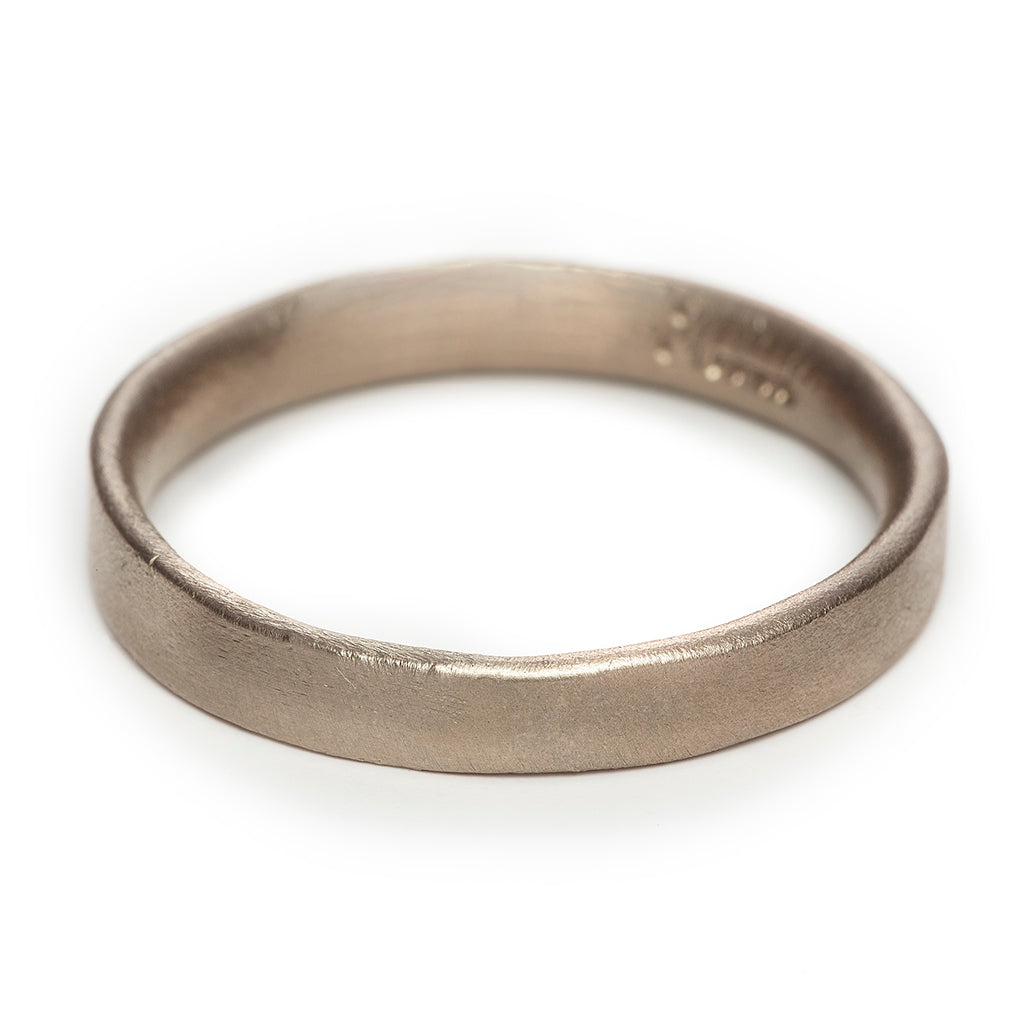 Matte white gold 4mm men's wedding band by Ruth Tomlinson, handmade in London