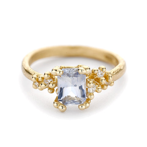Emerald cut blue sapphire engagement ring from Ruth Tomlinson, handmade in London