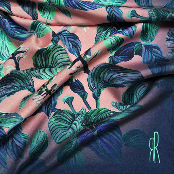 Palm paradise print with leaves and florals in turquoise and blue on pink background.  Ombre edges in blue.