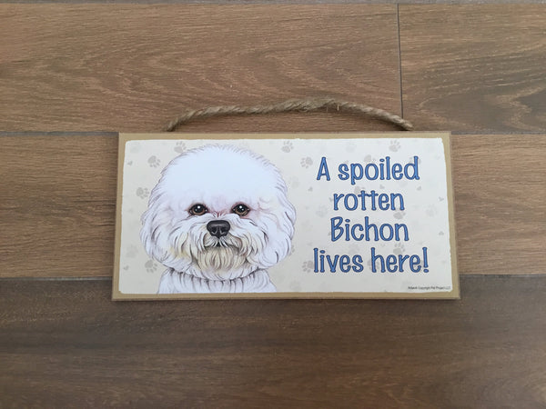 Sign with an image: A spoiled rotten Bichon lives here!