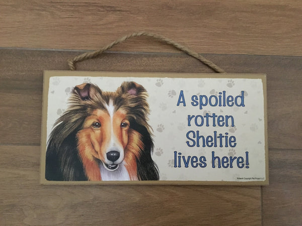 Sign and image - A spoiled rotten Sheltie lives here!