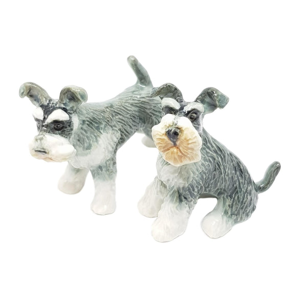 Set of 2 Schnauzers. The detail in these dogs make them perfect for any collection.  As our figurines are handcrafted & hand painted, colours and markings may vary.  This collectable figurine measures 5.3cm x 3cm x 5.5cm high.  Made in Thailand