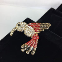 Beautiful crystal body bird brooch with red wings and tail