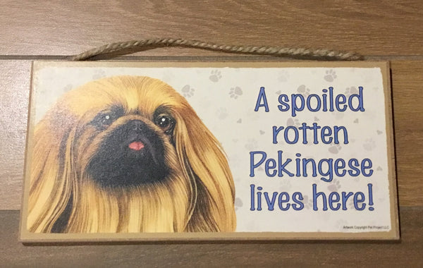 Sign and image - A spoiled rotten Pekingese lives here!