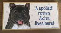 Sign and Image - A spoiled rotten Akita lives here!