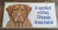 Sign with an image: A spoiled rotten Chessie lives here!