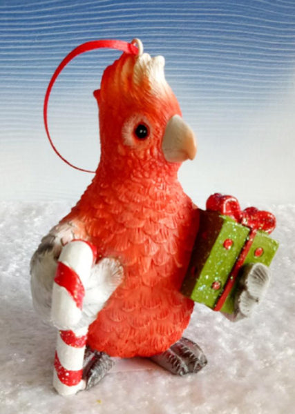 Beautiful Red Resin Parrot Xmas ornament. Parrot available in white or red.  Dimension: 75 mm x 70 mm x 105 mm