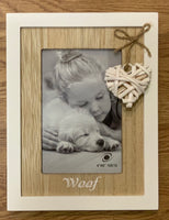 Photo Frame in White with wooden framing of photo 10 x 15cm. Has a wicker heart with Woof for Dog.  Great for the avid dog lover.