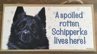 Sign and image - A spoiled rotten schipperke lives here!