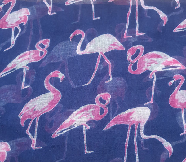 Navy Scarf Pink & White Flamingos. Beautifully made from  this elegant accessor is made from the finest materials such as fine cotton and /or blended yarns like linen, silk, viscose wool and others. Please handle with care in order to maintain its look.